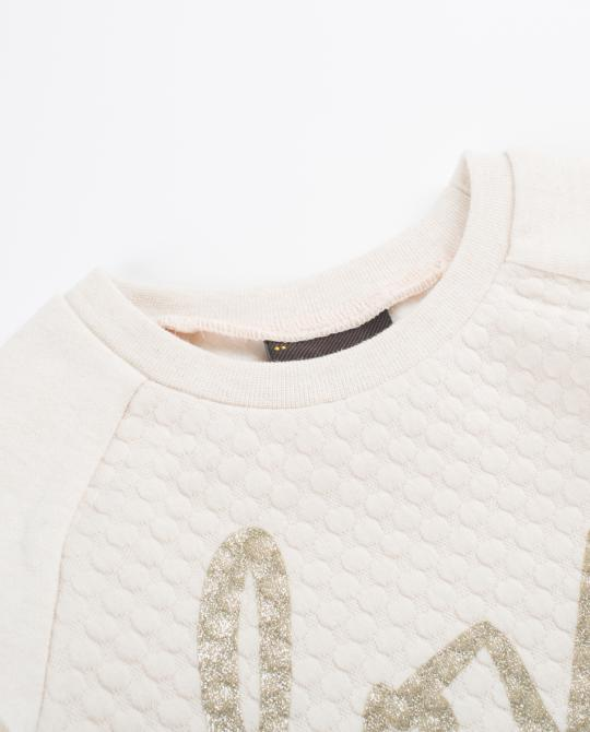 beige-sweater-met-glitterprint